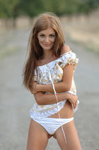 Nice Girl In A Short White Dress Stay Nude And Poses On The Country Road. - Picture 1